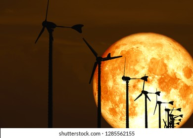 blood moon back Wind turbines produce wind energy which is a clean energy, Elements of this image furnished by NASA