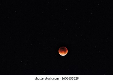 Blood Moon illuminated against the dark and starry sky