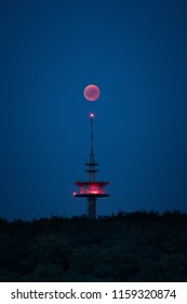 Blood moon red shining right above broadcasting tower germany