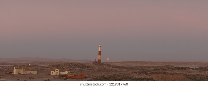 Blood Moon rising at the Luederitz Lighthouse in Diaz Point near Lüderitz, Namibia, Africa.