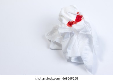 Blood on tissue paper on white background. Epistaxis (nosebleeds) treatment blood in tissue paper. Health medical treatment concept.
