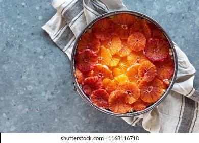 Blood Orange Almond Sunset Cake Batter Topped with Orange Slices in Pan Before Baking