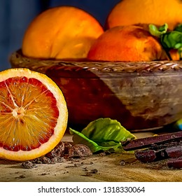 Blood oranges on a wooden surface with bars of chocolate. Stock Image.
