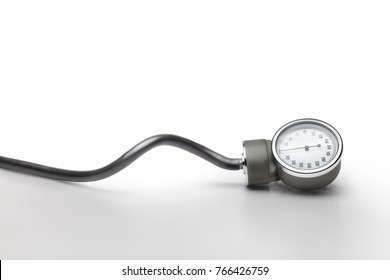 Blood pressure measurer against gray degraded background. Clipping path on measurer
