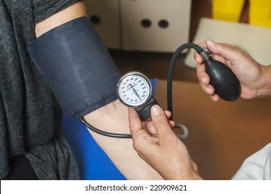 Blood pressure measuring. Doctor measuring patients blood pressure