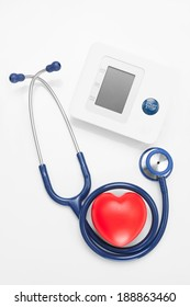 Blood pressure measuring tools with red heart - studio shoot on white