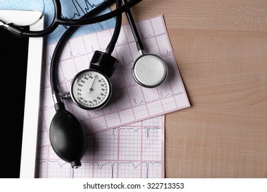 Blood pressure meter, digital tablet and stethoscope, on wooden background