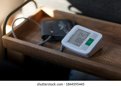 Blood pressure meter on a table at home