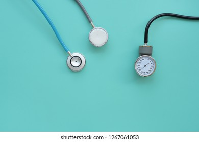 Blood pressure meter and stethoscope on blue background