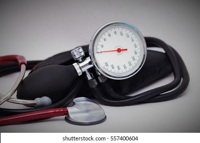 Blood pressure meter and stethoscope on white background