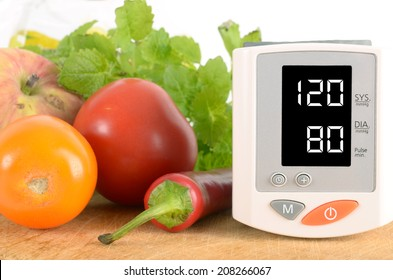 Blood pressure monitor with vegetables. Pressure gauge with vegetables. The concept shows that healthy food can keep the body in good condition.