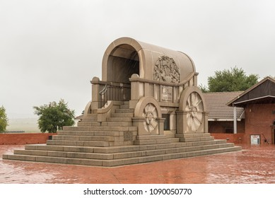 BLOOD RIVER, SOUTH AFRICA - MARCH 22, 2018: A granite replica of a typical Voortrekker jawbone wagon at Blood River in Kwazulu-Natal. Falling rain is visible