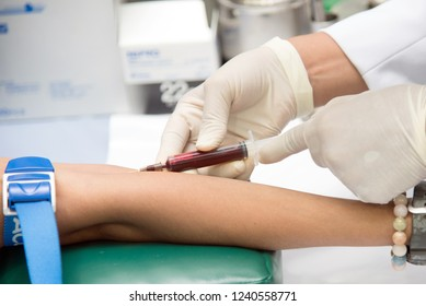 Blood sample from a vein, Nurse taking Real Blood samples analysis from a vein of the patient, laboratory on research of blood tests, to diagnose illness by means of a blood test,