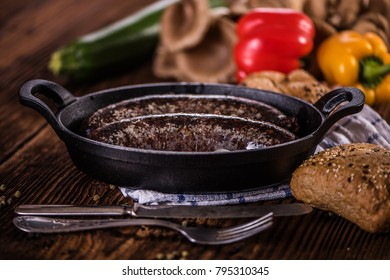 blood sausage in black iron cast dish