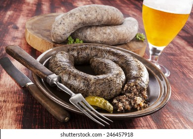 Blood sausage and rice sausage on wooden background. Culinary traditional european eating, rustic style.