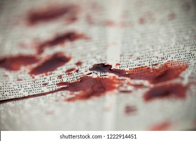 Blood spatter is seen on a vintage encyclopedia.
