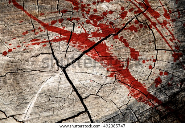 Blood splatters on surface tree stump wood background, top view.