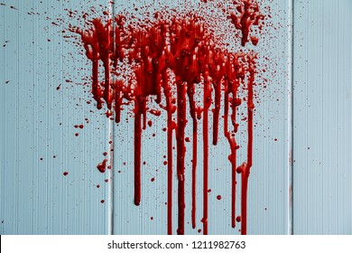 Blood stains on light wall