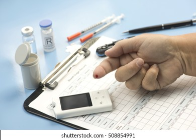 Blood sugar record with finger prick blood sample.  Document created by photographer.