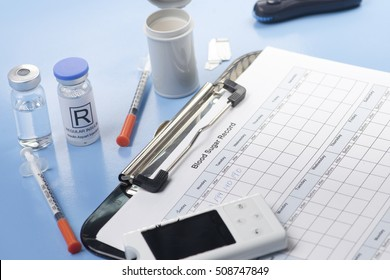 Blood sugar record with insulin and syringe.  Document created by photographer.