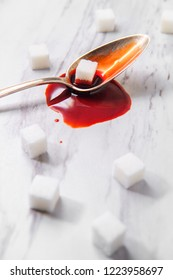 Blood sugar taken literally with sugar cubes for diabetes concept