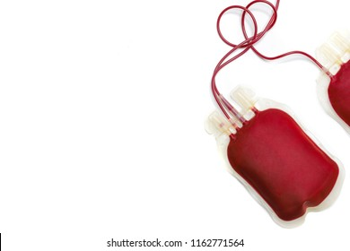 Blood transfusion bag. A plastic bag  filled with fresh red whole blood on white background, medical, medicine. Blood bank, transfusion, donation, treatment, replacement. Promotional cause, Top view.