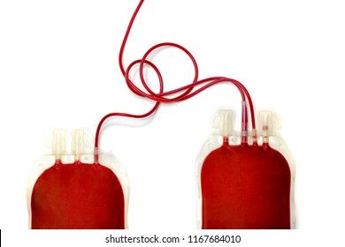 Blood transfusion bags. Two plastic bags filled with fresh human red blood on white background. Blood bank, transfusion, donation, replacement, campaign Top view.