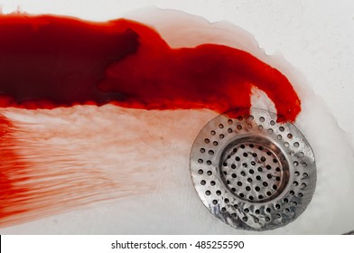 Blood washing down the drain representing a suicide or homicide attempt