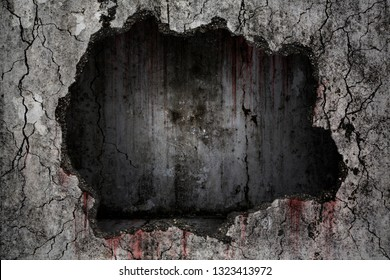 Bloody background scary on damaged grungy crack and broken concrete wall with empty dark room inside on the wall, concept of horror