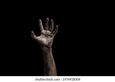 Bloody dirty zombie hand on black background with copy space. Halloween concept.