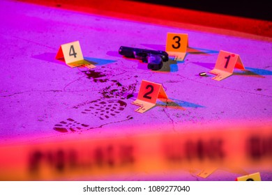 A bloody footprint and firearm are marked with evidence markers within a crime scene. Cordon tape can be seen in the foreground.