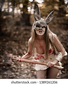 Bloody girl with an axe wearing a rabbit mask