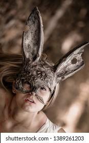 Bloody girl wearing a rabbit mask