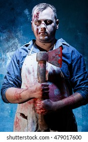 Bloody Halloween theme: crazy killer as butcher with an ax