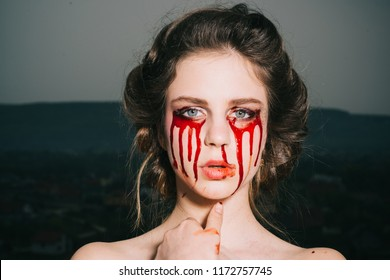 bloody halloween. woman with blood eyes. happy halloween party. death and scary magic girl with blood tears on face. I love being witchy. bloody mary.
