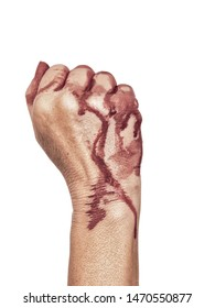 Bloody hand, clenched in a fist, isolated on white. Female.