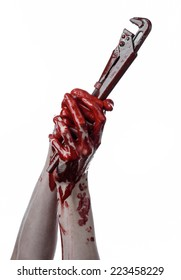 bloody hand holding an adjustable wrench, bloody key, crazy plumber, bloody theme, halloween theme, white background,isolated, bloody hand of an assassin, bloody murderer, psycho, bloody monkey wrench