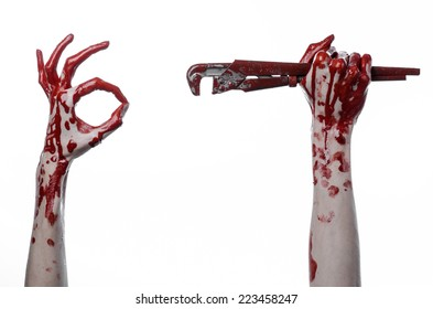 bloody hand holding an adjustable wrench, crazy plumber, halloween theme, white background, isolated, murderer, psycho