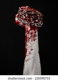 bloody hand holding chain, bloody chain, halloween theme, black background, isolated, killer, fan, crazy