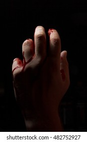 Bloody hands emerge from the darkness in horror Halloween image