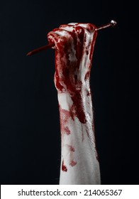 Bloody hands with nail, black background, zombie, demon, maniac