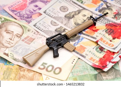 bloody hundred dollars and ukrainian hryvnia and american m16 assault rifle armed conflict support concept