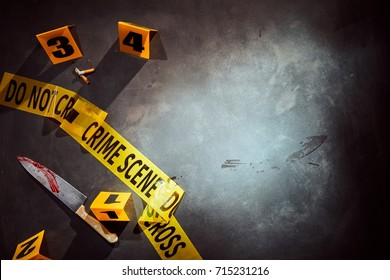 Bloody knife and cigarette stubs at a police crime scene with yellow tape and numbered clues with copy space alongside