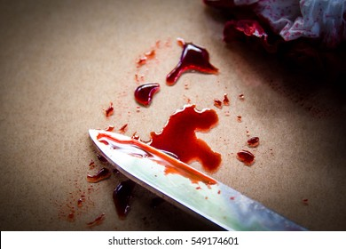 Bloody knife and tissue paper,Violence