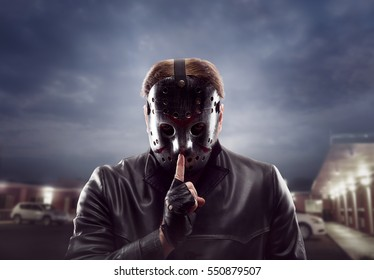 Bloody maniac in hockey mask show do not talk sign