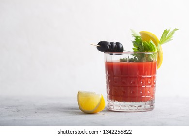 Bloody Mary is a cocktail containing vodka, some tomato juice, different spices and flavorings, such as Worcestershire sauce, hot sauces, celery. Image contains copy space for your text