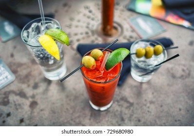 Bloody Mary Cocktail Gin and Olives Alcoholic Drinks with Lime Garnish at Resort Bar