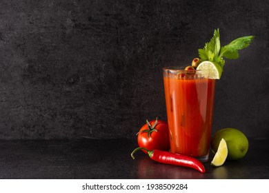 Bloody Mary cocktail in glass on black background.Copy space