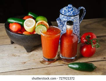 Bloody Mary cocktail next to a bowl of fruit and vegetables