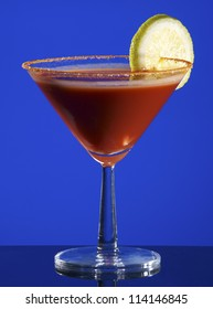Bloody Mary Cocktail on blue background.